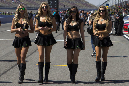 stock news: Fontana, CA - Mar 21, 2015:  The Monster Enegery girls walk down pit road before the Drive4Clots.com 300 at Auto Club Speedway in Fontana, CA.