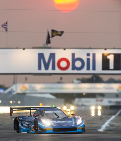 fl: Sebring, FL - Mar 19, 2015:  The Spirit of Daytona Corvette DP Prototype races through the turns at 12 Hours of Sebring at Sebring Raceway in Sebring, FL. Editorial