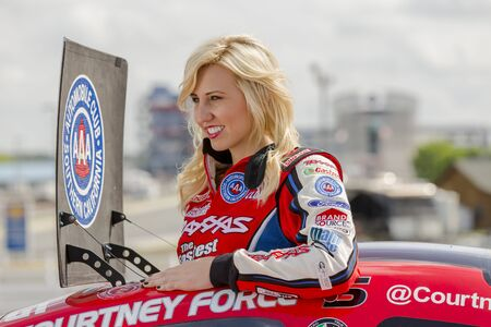 CONCORD, NC - APR 18, 2013:  NHRA Funny Car driver, Courtney Force, shoots a promotional commercial for ZMAX Drageway  in Concord, NC. 에디토리얼