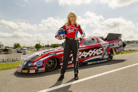 dragster: CONCORD, NC - APR 18, 2013:  NHRA Funny Car driver, Courtney Force, shoots a promotional commercial for ZMAX Drageway  in Concord, NC. Editorial