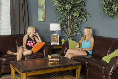 slumber: Two young attractive women enjoying a slumber party Stock Photo