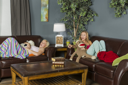 slumber party: Two young attractive women enjoying a slumber party Stock Photo