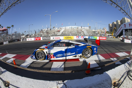 prix: Long Beach, CA - Apr 17, 2015:  The Chip Ganassi Racing car races through the turns at the Toyota Grand Prix of Long Beach at Long Beach Grand Prix in Long Beach, CA.