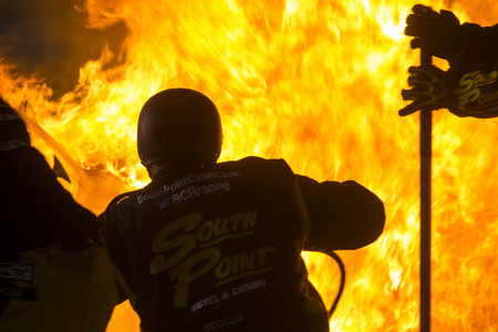 raceway: Richmond, VA - Apr 24, 2015: Brendan Gaughan (62) pulls into the pits on fire during the ToyotaCare 250 at Richmond International Raceway in Richmond, VA.