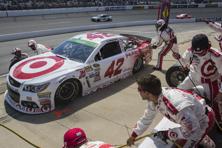 kyle: Richmond, VA - Apr 26, 2015:  Kyle Larson (42) brings his race car in for service during the Toyota Owners 400 race at the Richmond International Raceway in Richmond, VA.
