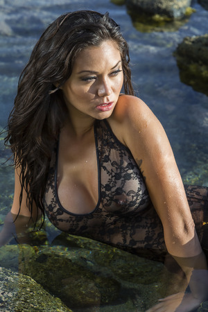 A brunette model posing on a beach Stock Photo