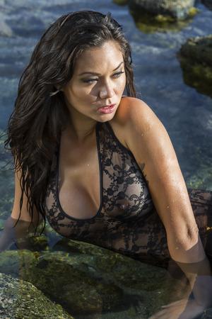 A brunette model posing on a beach Archivio Fotografico