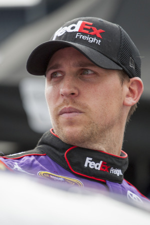 tn: Bristol, TN - Apr 17, 2015:  Denny Hamlin (11) watches his crew work during a practice session for the Food City 500 at Bristol Motor Speedway in Bristol, TN.