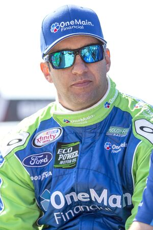 raceway: Richmond, VA - Apr 24, 2015:  Elliott Sadler (1) watches his crew work during a practice session for the ToyotaCare 250 at Richmond International Raceway in Richmond, VA. Editorial