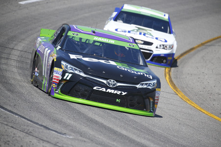 va: Richmond, VA - Apr 24, 2015:  Denny Hamlin (11) brings his race car through the turns during a practice session for the Toyota Owners 400 race at the Richmond International Raceway in Richmond, VA.