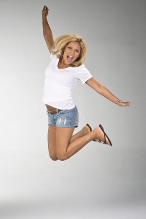 blonde minority: A pretty ethnic blonde model posing in a studio environment.