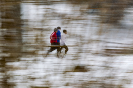 joggers: Joggers running on a snowy day Stock Photo