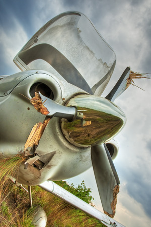 Small general aviation aircraft crash lands in a field Stock Photo