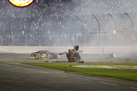 dillon: Daytona, FL - Jul 06, 2015:  The remains of the car of Austin Dillon (3) sit in the grass after wrecking on the final lap of the Coke Zero 400 at Daytona International Speedway in Daytona, FL. Editorial