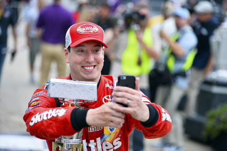 kyle: Indianapolis, IN - Jul 26, 2015: Kyle Busch (18) celebrates in victory lane after winning the Crown Royal Presents the Jeff Kyle 400 at the Brickyard at Indianapolis Motor Speedway in Indianapolis, IN.