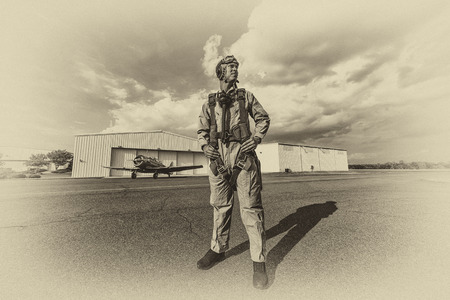 pilot: A brunette model in vintage clothing with a pilot and a WW II aircraft