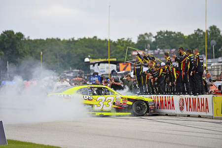 chevy: Elkhart Lake, WI - Aug 29, 2015:  Paul Menard (33) celebrates with a burnout after winning the Road America 180 Fired up by Johnsonville after leading the field through across the finish line in the RichmondMenards Chevy at Road America in Elkhart Lake,