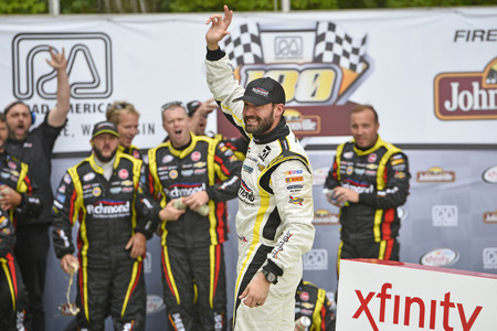 chevy: Elkhart Lake, WI - Aug 29, 2015:  Paul Menard (33) celebrates in victory lane after winning the Road America 180 Fired up by Johnsonville in the RichmondMenards Chevy at Road America in Elkhart Lake, WI. Editorial