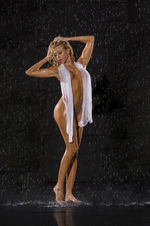 aqua naked: Model posing against a studio rain curtain