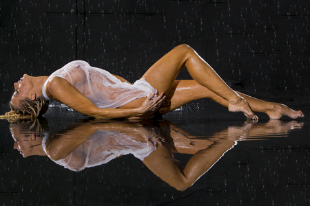 sexy breasts: Model posing against a studio rain curtain