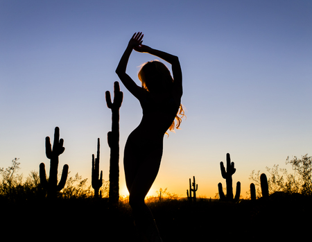 southwest: A model posing in the desert of the American Southwest at sunset. Stock Photo