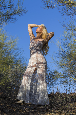 southwest: A blonde model posing in the desert of the American Southwest