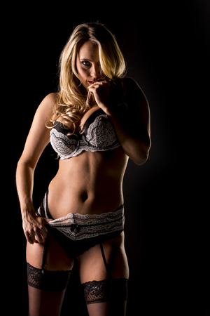 eos: A beautiful blonde model posing in a studio environment Stock Photo