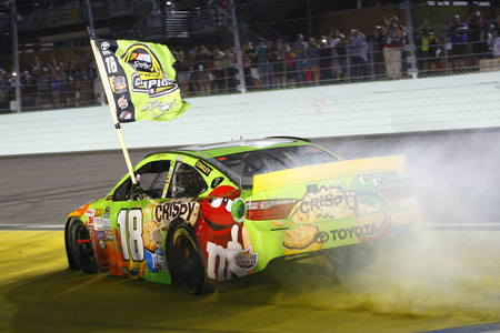 nascar: Homestead, FL - Nov 23, 2015: Kyle Busch (18) wins the 2015 NASCAR Sprint Cup Championship following the FORD EcoBoost 400 at Homestead Miami Speedway in Homestead, FL.