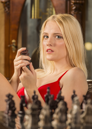 challenging sex: a female model playing chess, posing in erotic positions