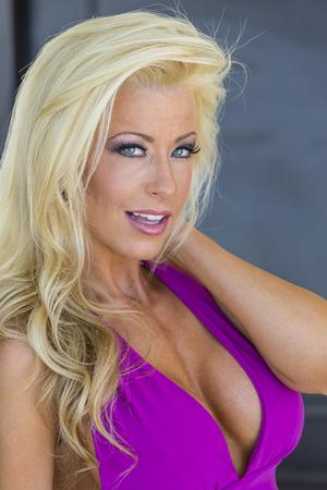Attractive blonde model posing in an elegant evening dress Stock fotó