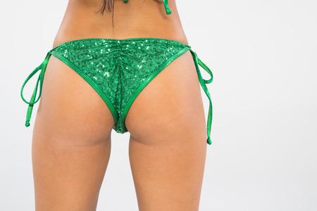 bikini butt: An asian bikini model posing in a studio environment