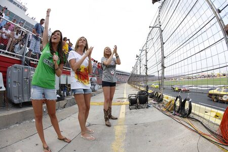 nscs: CONCORD, NC - MAY 29, 2011:  NASCAR fans show their support for their favorite team during the Coca-Cola 600 race at the Charlotte Motor Speedway in Concord, NC. Editorial