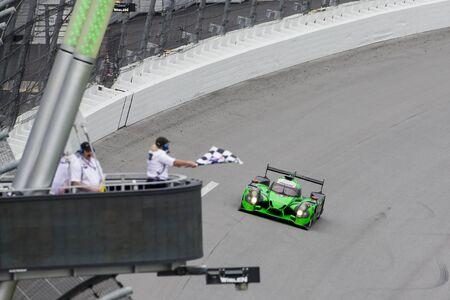 fl: Daytona Beach, FL - Jan 31, 2016:  The Extreme Motorsports Honda takes the checkered flag, winning the Rolex 24 at Daytona at Daytona International Speedway in Daytona Beach, FL.