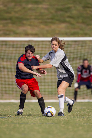 Image of a male and female soccer player in action photo
