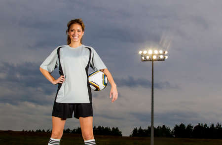 Female soccer player working out on a soccer field photo