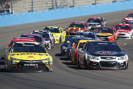 az: Avondale, AZ - Mar 13, 2016: Carl Edwards (19) and Kevin Harvick (4) races off turn four during the Good Sam 500(k) at the Phoenix International Raceway in Avondale, AZ. Editorial