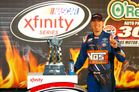 kyle: Ft. Worth, TX - Apr 08, 2016: Kyle Busch (18) celebrates after winning the OReilly Auto Parts 300 at the Texas Motor Speedway in Ft. Worth, TX.
