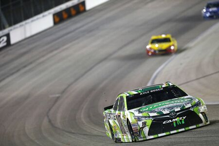 nscs: Ft. Worth, TX - Apr 09, 2016: Kyle Busch (18) battles for position during the Duck Commander 500 at the Texas Motor Speedway in Ft. Worth, TX.