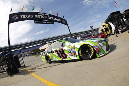tx: Ft. Worth, TX - Apr 07, 2016: Kyle Busch (18) brings his race car in for service during practice for the Duck Commander 500 at the Texas Motor Speedway in Ft. Worth, TX.