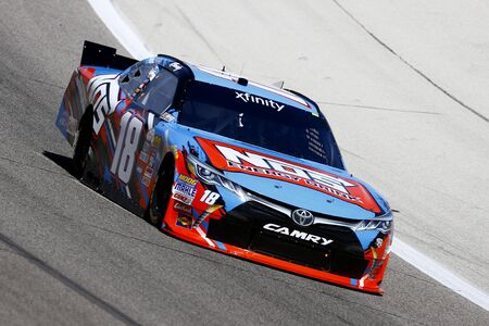 tx: Ft. Worth, TX - Apr 07, 2016: Kyle Busch (18) brings his race car through the turns during practice for the OReilly Auto Parts 300 at the Texas Motor Speedway in Ft. Worth, TX.