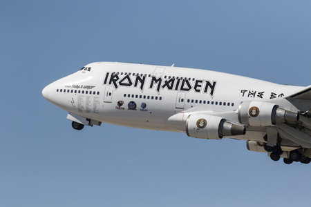 747 400: Los Angeles, CA - Apr 17, 2016: The rock group, Iron Maiden, take off from Los Angeles International Airport in Los Angeles, CA. after their North American tour and head to the Far East to continue their Book Of Souls World Tour.