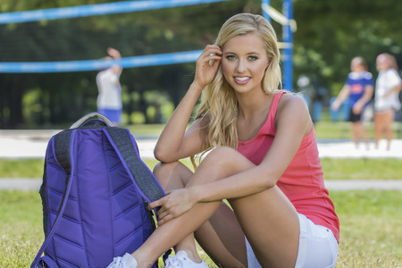 coed: A blonde coed model posing in an outdoor environment