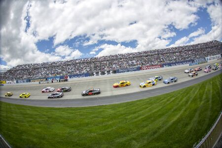 aaa: Dover, DE - May 15, 2016: The NASCAR Sprint Cup series teams take to the track for the AAA 400 Benefiting Autism Speaks  at the Dover International Speedway in Dover, DE.