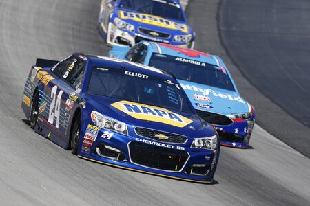 speaks: Dover, DE - May 15, 2016: Chase Elliott (24) brings his race car through the turns during the AAA 400 Benefiting Autism Speaks  at the Dover International Speedway in Dover, DE. Editorial