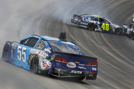 aaa: Dover, DE - May 15, 2016: Jimmie Johnson (48) and Reed Sorenson (55) wreck the AAA 400 Benefiting Autism Speaks  at the Dover International Speedway in Dover, DE. Editorial