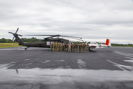 blackhawk helicopter: Concord, NC - May 29, 2016: The 82nd Combat Aviation Brigade pose with their aircraft and some vintage airplanes before the Coca Cola 600 at the Charlotte Motor Speedway in Concord, NC.