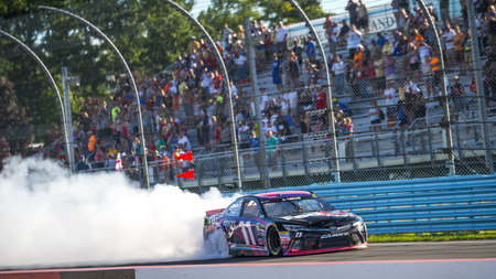 Watkins Glen, NY - Aug 07, 2016: Denny Hamlin celebrates his victory in the #11 FedEx Freight Toyota  during the CHEEZ-IT 355 at the Glen weekend at the Watkins Glen International in Watkins Glen, NY. Editorial