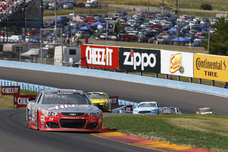 nscs: Watkins Glen, NY - Aug 07, 2016: Tony Stewart (14) races his car through the esses during the Cheez-It 350 at the Glen at the Watkins Glen International in Watkins Glen, NY.