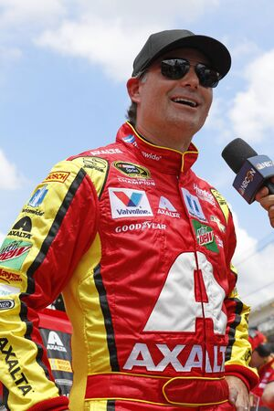 coalition: Speedway, IN - Jul 23, 2016: Jeff Gordon (88) hangs out on pit road during qualifying for the Combat Wounded Coalition 400 at the Indianapolis Motor Speedway in Speedway, IN.
