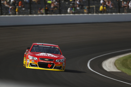 coalition: Speedway, IN - Jul 24, 2016: Jeff Gordon (88) battles for position during the Combat Wounded Coalition 400 at the Indianapolis Motor Speedway in Speedway, IN.